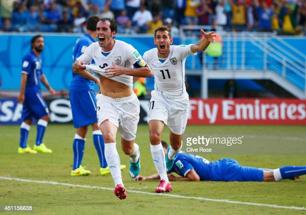 Diego Godin of Uruguay celebrates scoring his team's first goal during the 2014 FIFA World Cup Brazil Group D match between Italy and Uruguay at...