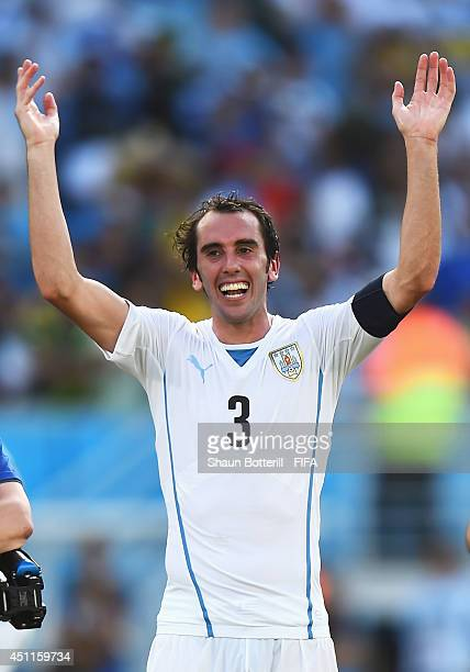 Diego Godin of Uruguay celebrates the 10 win in the 2014 FIFA World Cup Brazil Group D match between Italy and Uruguay at Estadio das Dunas on June...
