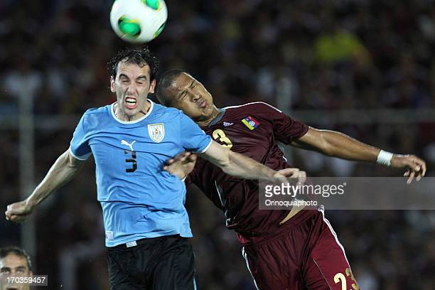 Diego Godin of Uruguay competes for the ball with Jose Salomon Rondon of Venezuela during a match between Venezuela and Uruguay as part of the 14th...