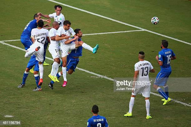 Diego Godin of Uruguay goes up for a header and scores his team's first goal during the 2014 FIFA World Cup Brazil Group D match between Italy and...