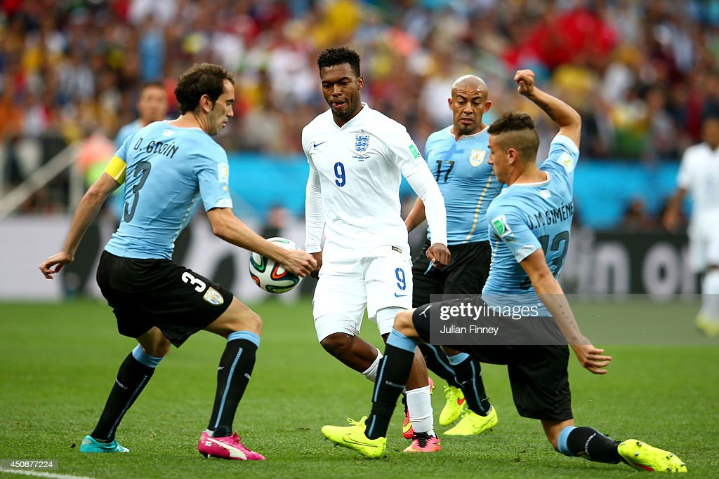 <a gi-track='captionPersonalityLinkClicked' href=/galleries/search?phrase=Diego+Godin&family=editorial&specificpeople=608999 ng-click='$event.stopPropagation()'>Diego Godin</a> of Uruguay handles the ball as <a gi-track='captionPersonalityLinkClicked' href=/galleries/search?phrase=Daniel+Sturridge&family=editorial&specificpeople=677270 ng-click='$event.stopPropagation()'>Daniel Sturridge</a> of England looks on during the 2014 FIFA World Cup Brazil Group D match between Uruguay and England at Arena de Sao Paulo on June 19, 2014 in Sao Paulo, Brazil.