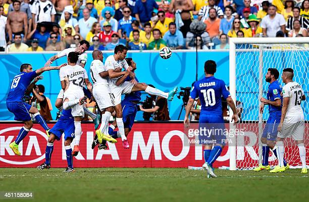 Diego Godin of Uruguay scores his team's first goal during the 2014 FIFA World Cup Brazil Group D match between Italy and Uruguay at Estadio das...