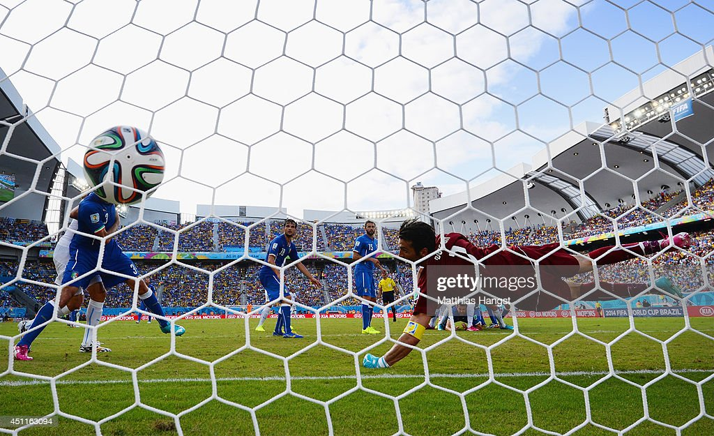 <a gi-track='captionPersonalityLinkClicked' href=/galleries/search?phrase=Diego+Godin&family=editorial&specificpeople=608999 ng-click='$event.stopPropagation()'>Diego Godin</a> of Uruguay scores his team's first goal past goalkeeper <a gi-track='captionPersonalityLinkClicked' href=/galleries/search?phrase=Gianluigi+Buffon&family=editorial&specificpeople=208860 ng-click='$event.stopPropagation()'>Gianluigi Buffon</a> of Italy during the 2014 FIFA World Cup Brazil Group D match between Italy and Uruguay at Estadio das Dunas on June 24, 2014 in Natal, Brazil.