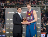 Diego Guillen Competition Director of Euroelague Basketball gives to Ante Tomic #44 of FC Barcelona Regal the bwin MVP February trophy before the...