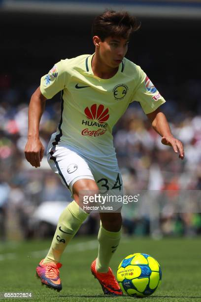 Diego Lainez of America drives the ball during the 11th round match between Pumas UNAM and America as part of the Torneo Clausura 2017 Liga MX at...