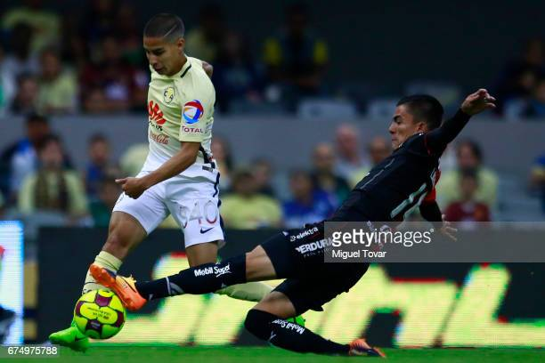 Diego Lainez of America fights for the ball with Luis Reyes of Atlas during the 16th round match between America and Atlas as part of the Torneo...