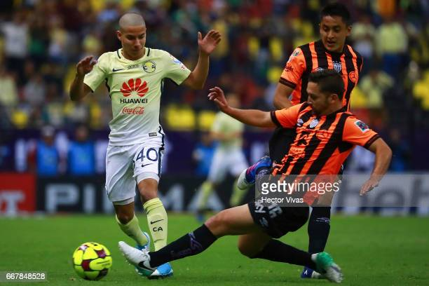 Diego Lainez of America struggles for the ball with Manuel Iturra of Necaxa during the 10th round match between America and Necaxa as part of the...