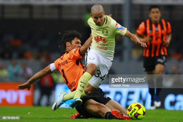 Diego Lainez of America struggles for the ball with Marcos Gonzalez of Necaxa during the 10th round match between America and Necaxa as part of the...