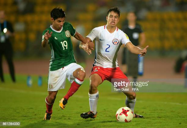 Diego Lainez of Mexico and Gaston Zuniga of Chile in action during the FIFA U17 World Cup India 2017 group E match between Mexico and Chile at Indira...