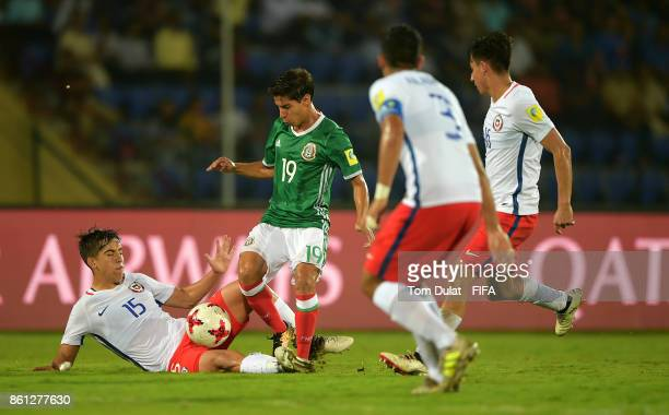 Diego Lainez of Mexico and Sebastian Valencia of Chile in action during the FIFA U17 World Cup India 2017 group E match between Mexico and Chile at...