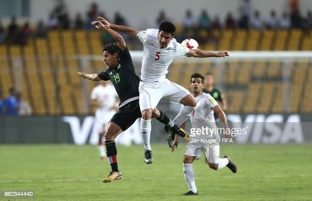 Diego Lainez of Mexico battles with Majid Nasiri of Iran during the FIFA U17 World Cup India 2017 Round of 16 match between Iran and Mexico at Pandit...
