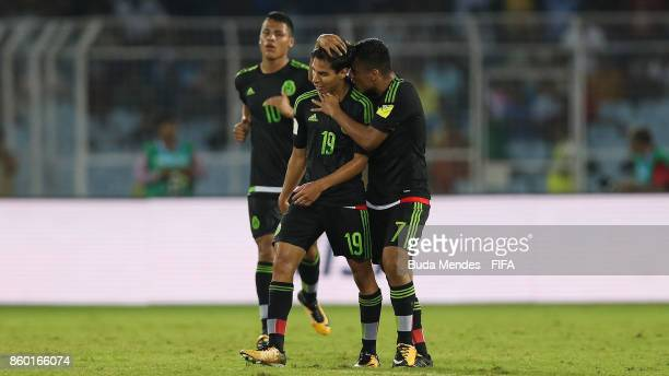 Diego Lainez of Mexico celebrates a scored goal with his teammates during the FIFA U17 World Cup India 2017 group F match between England and Mexico...