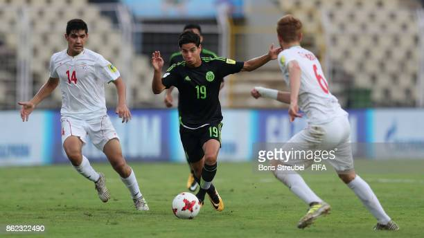 Diego Lainez of Mexico is challenged by Taha Shariati of Iran and Ali Davaran of Iran during the FIFA U17 World Cup India 2017 Round of 16 match...