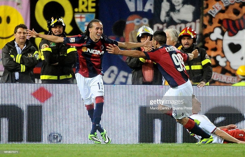 <a gi-track='captionPersonalityLinkClicked' href=/galleries/search?phrase=Diego+Laxalt&family=editorial&specificpeople=11047544 ng-click='$event.stopPropagation()'>Diego Laxalt</a> # 13 of Bologna FC celebrates after scoring his team's second goal during the Serie A match between Bologna and AC Milan at Stadio Renato Dall'Ara on September 25, 2013 in Bologna, Italy.
