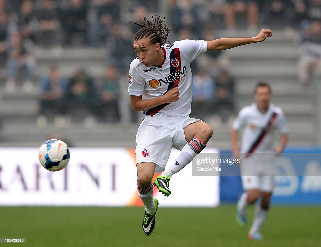 <a gi-track='captionPersonalityLinkClicked' href=/galleries/search?phrase=Diego+Laxalt&family=editorial&specificpeople=11047544 ng-click='$event.stopPropagation()'>Diego Laxalt</a> of Bologna FC in action during the Serie A match between US Sassuolo Calcio and Bologna FC on October 20, 2013 in Reggio nell'Emilia, Italy.