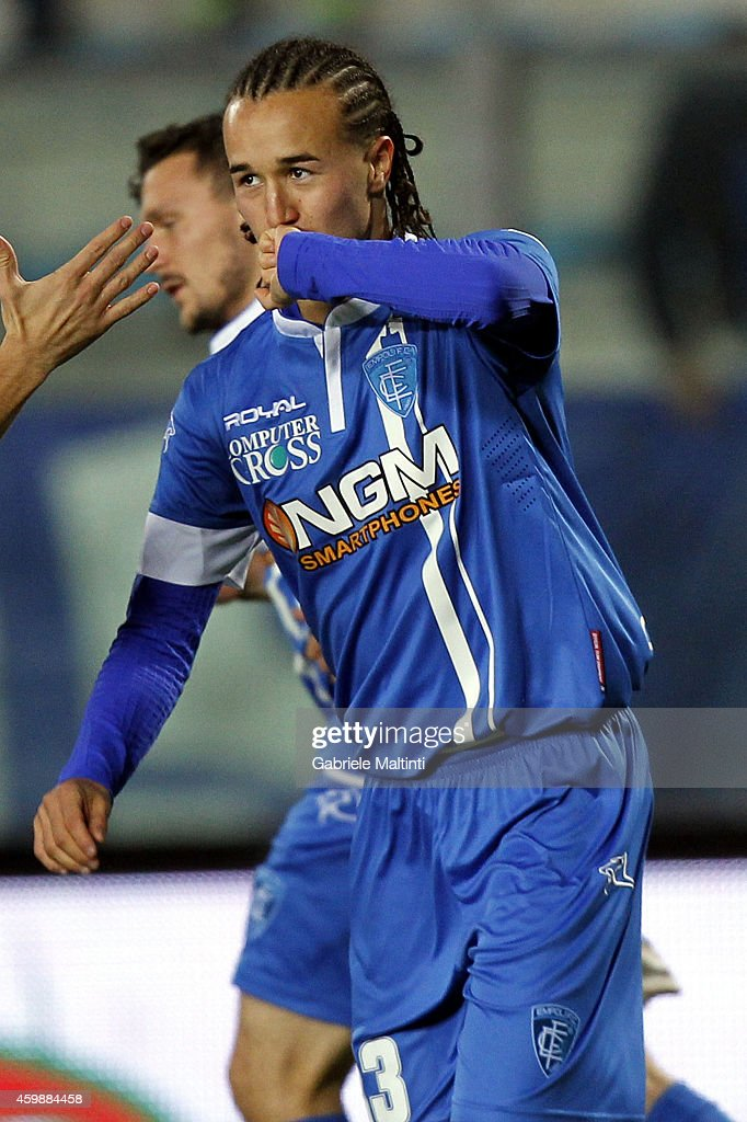 <a gi-track='captionPersonalityLinkClicked' href=/galleries/search?phrase=Diego+Laxalt&family=editorial&specificpeople=11047544 ng-click='$event.stopPropagation()'>Diego Laxalt</a> of Empoli FC celebrates after scoring a goal during the TIM Cup Match between Empoli FC and Genoa CFC at Stadio Carlo Castellani on December 3, 2014 in Empoli, Italy.