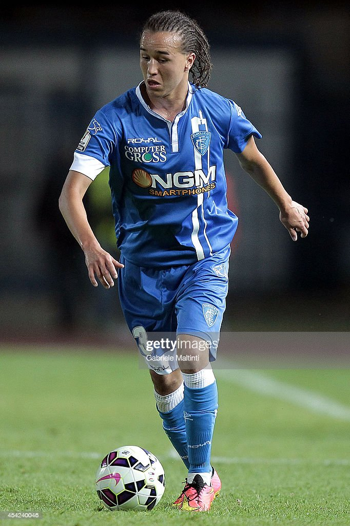 <a gi-track='captionPersonalityLinkClicked' href=/galleries/search?phrase=Diego+Laxalt&family=editorial&specificpeople=11047544 ng-click='$event.stopPropagation()'>Diego Laxalt</a> of Empoli FC in action during the TIM Cup match between Empoli FC and L'Aquila Calcio at Stadio Carlo Castellani on August 24, 2014 in Empoli, Italy.