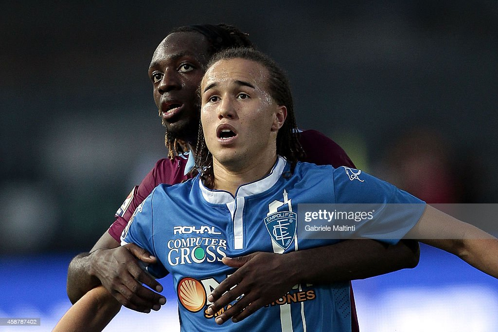 <a gi-track='captionPersonalityLinkClicked' href=/galleries/search?phrase=Diego+Laxalt&family=editorial&specificpeople=11047544 ng-click='$event.stopPropagation()'>Diego Laxalt</a> of Empoli FC in action with Luis Pedro Cavanda during the Serie A match between Empoli FC and SS Lazio at Stadio Carlo Castellani on November 9, 2014 in Empoli, Italy.