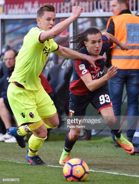 Diego Laxalt of Genoa and Emil Krafth of Bologna in action during the Serie A match between Genoa CFC and Bologna FC at Stadio Luigi Ferraris on...