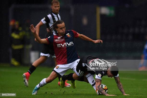 Diego Laxalt of Genoa and Rodrigo Javier De Paul of Udinese compete for the ball during the Serie A match between Udinese Calcio and Genoa CFC at...