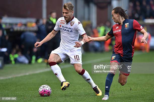 Diego Laxalt of Genoa CFC competes with Ciro Immobile of Torino FC during the Serie A match between Genoa CFC and Torino FC at Stadio Luigi Ferraris...