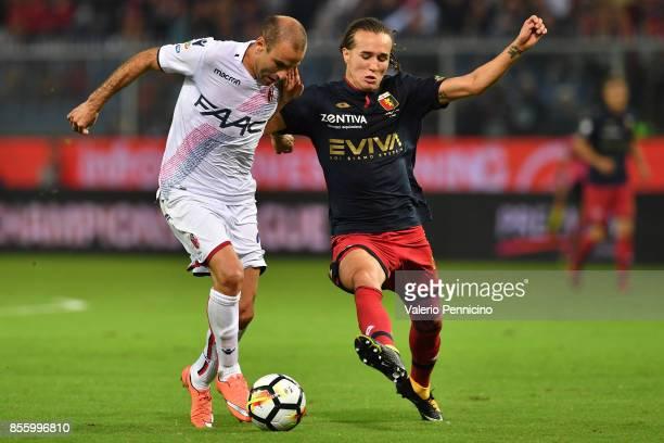 Diego Laxalt of Genoa CFC competes with Rodrigo Palacio of Bologna FC during the Serie A match between Genoa CFC and Bologna FC at Stadio Luigi...