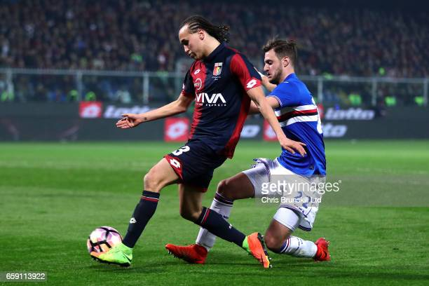 Diego Laxalt of Genoa CFC in action with Jacopo Sala of UC Sampdoria during the Serie A match between Genoa CFC and UC Sampdoria at Stadio Luigi...