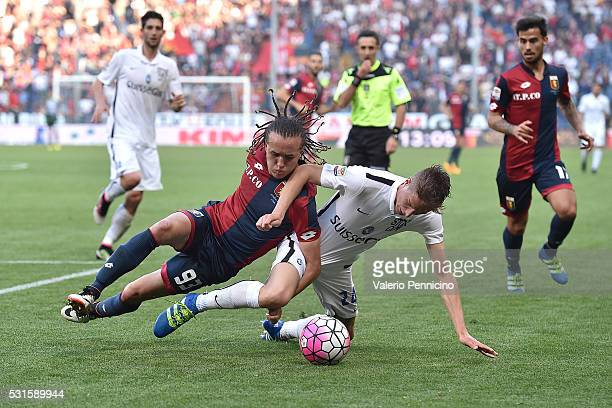 Diego Laxalt of Genoa CFC is tackled by Andrea Conti of Atalanta BC during the Serie A match between Genoa CFC and Atalanta BC at Stadio Luigi...