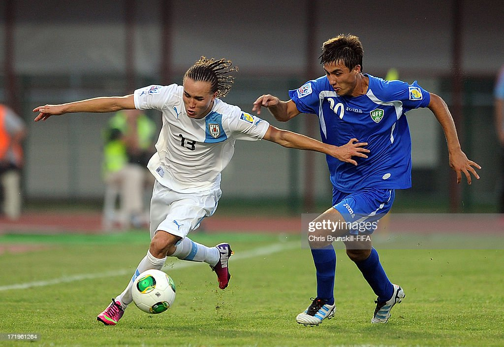 Diego Laxalt (L) of Uruguay in action with Mukhsinjon Ubaydullaev of Uzbekistan during the FIFA U20 World Cup Group F match between Ukbekistan and Uruguay at Akdeniz University Stadium on June 29, 2013 in Antalya, Turkey.