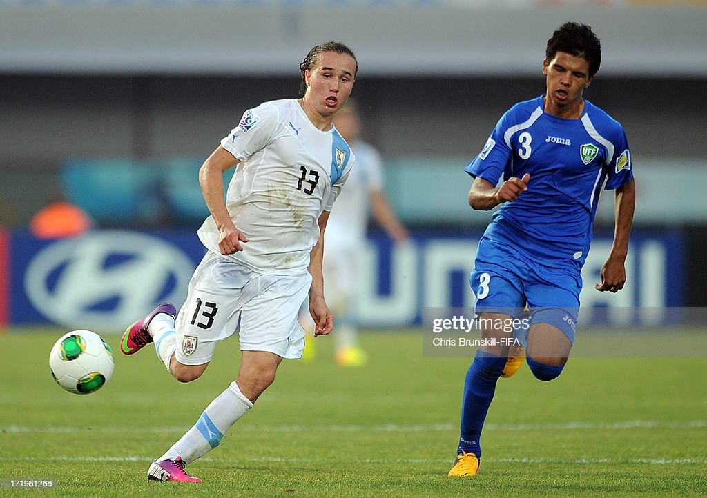 Diego Laxalt (L) of Uruguay in action with Sardor Rakhmanov of Uzbekistan during the FIFA U20 World Cup Group F match between Ukbekistan and Uruguay at Akdeniz University Stadium on June 29, 2013 in Antalya, Turkey.