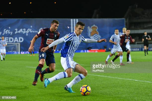 Diego Llorente duels for the ball with Sergi Enrich of Eibar during the Spanish league football match between Real Sociedad and Eibar at the Anoeta...