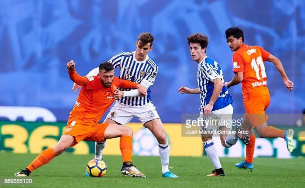 Diego Llorente of Real Sociedad duels for the ball with Borja Gonzalez of Malaga CF during the La Liga match between Real Sociedad de Futbol and Real...