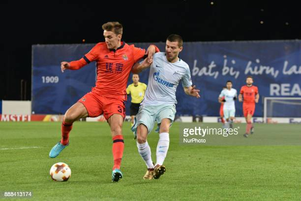 Diego Llorente of Real Sociedad duels for the ball with Dmitri Poloz of Zenit during the UEFA Europa League Group L football match between Real...