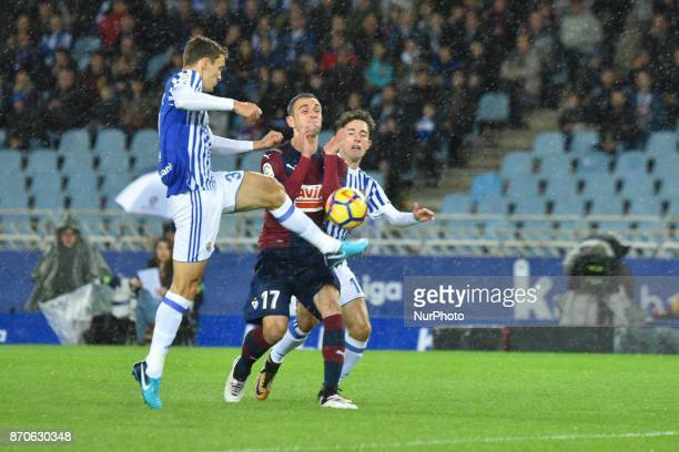 Diego Llorente of Real Sociedad duels for the ball with Kike García of Eibar during the Spanish league football match between Real Sociedad and Eibar...