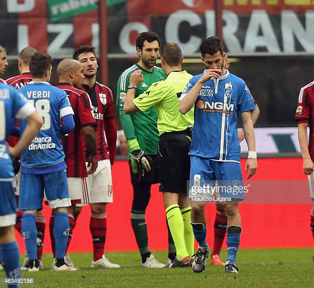 Diego Lopeezof Milan and the referee Paolo Valeri chat during the Serie A match between AC Milan and Empoli FC at Stadio Giuseppe Meazza on February...