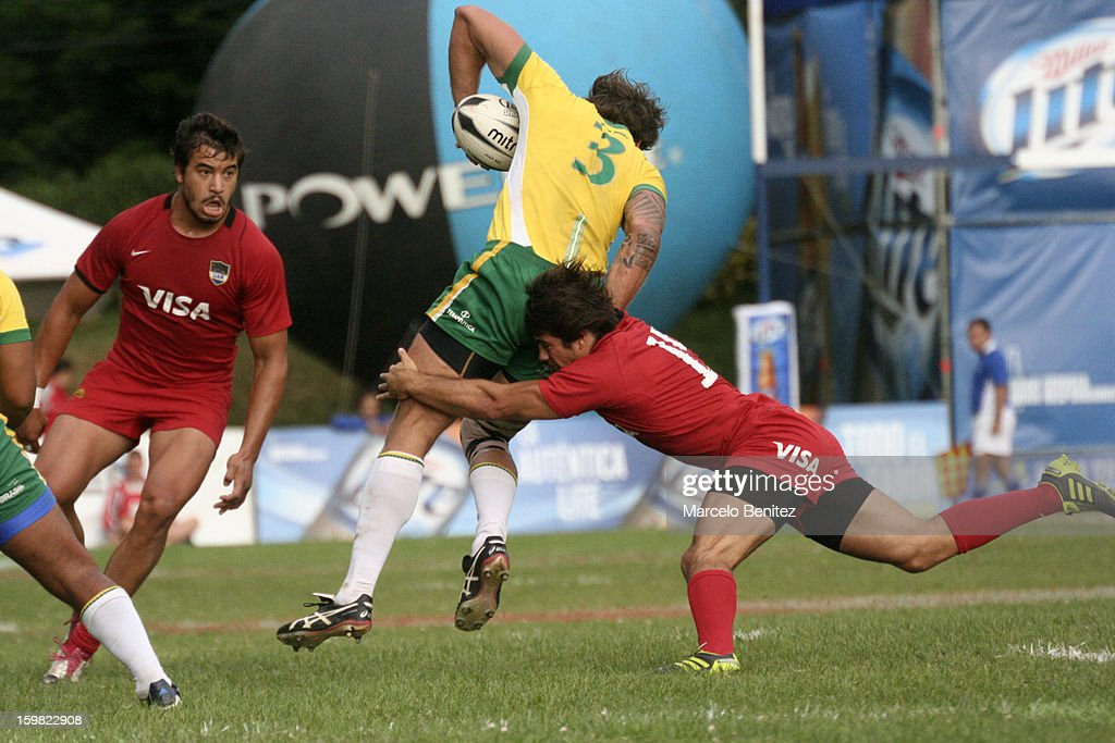 Diego Lopez of Brazil is tackled by Javier Rojas of Argentina during the International Seven Tournament Viña del Mar 2013 on January 20, 2013 in Viña del Mar, Chile.