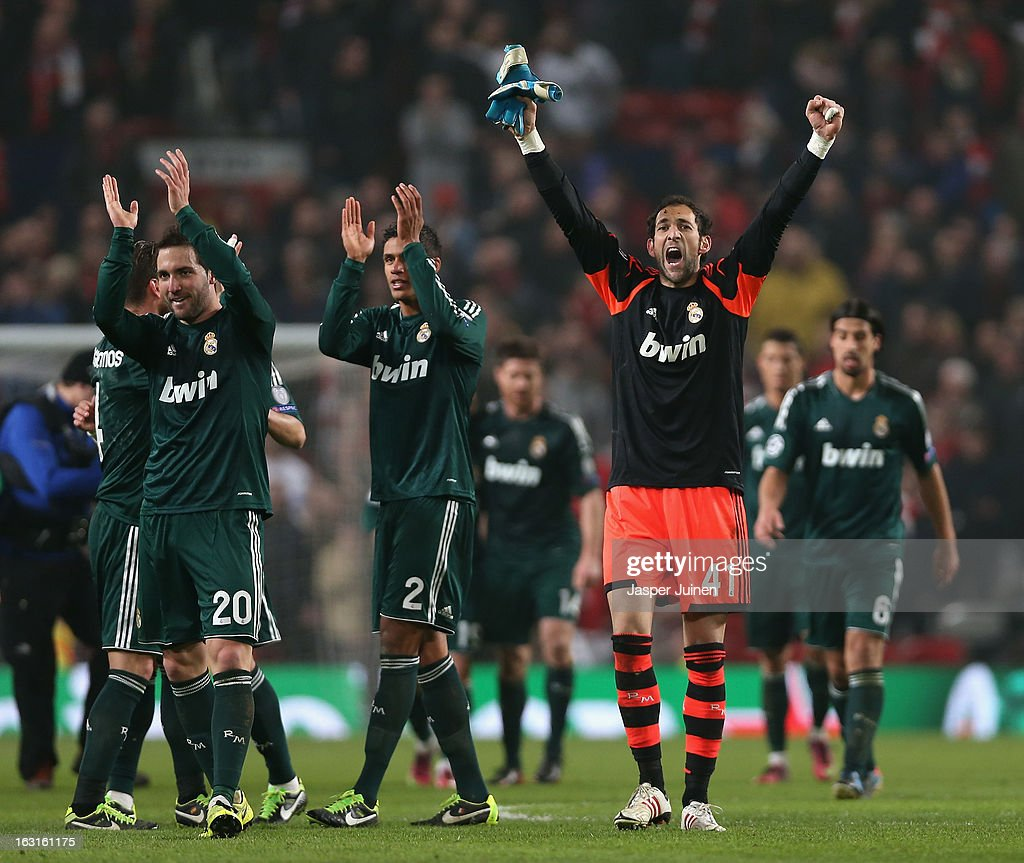 Diego Lopez of Real Madrid and his team-mates celebrate at the end of the UEFA Champions League Round of 16 Second leg match between Manchester United and Real Madrid at Old Trafford on March 5, 2013 in Manchester, United Kingdom.