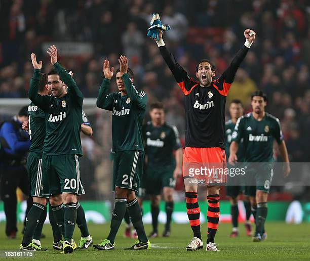 Diego Lopez of Real Madrid and his teammates celebrate at the end of the UEFA Champions League Round of 16 Second leg match between Manchester United...