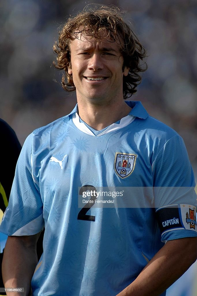 Diego Lugano from Uruguay during the national anthem prior to the friendly match between Uruguay and Holland at Centenario Stadium on June 082011 in...