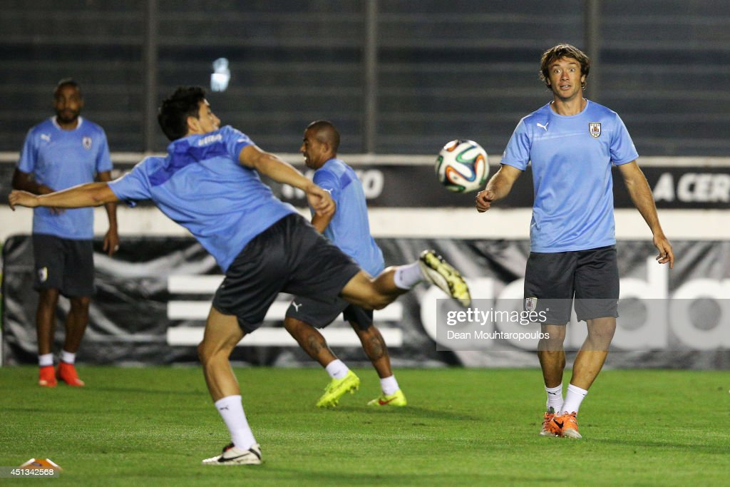 Diego Lugano in action during the first Uruguay training session since team mate Luis Suarez was suspended by FIFA at the 2014 FIFA World Cup held at...