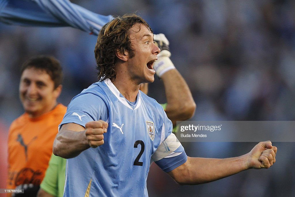Diego Lugano of Uruguay celebrates championship title during the Copa America 2011 final match between Uruguay and Paraguay at Monumental Antonio...