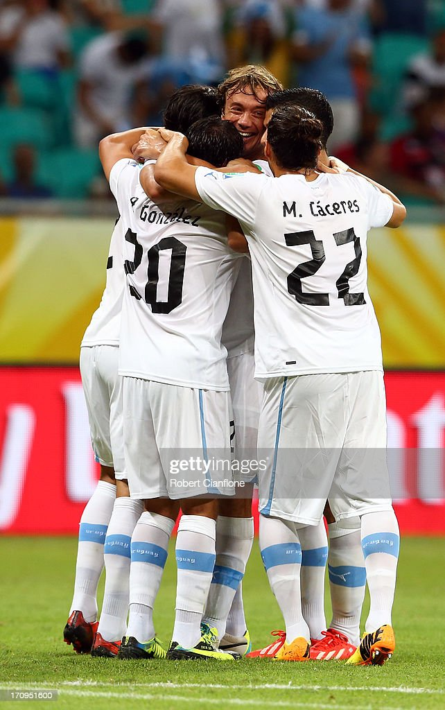 Diego Lugano of Uruguay celebrates with his teammates after scoring the opening goal during the FIFA Confederations Cup Brazil 2013 Group B match...