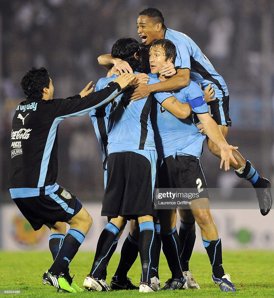 Diego Lugano of Uruguay celebrates with Sebastian Abreu after the 2010 FIFA World Cup Play Off Second Leg Match between Uruguay and Costa Rica at The...