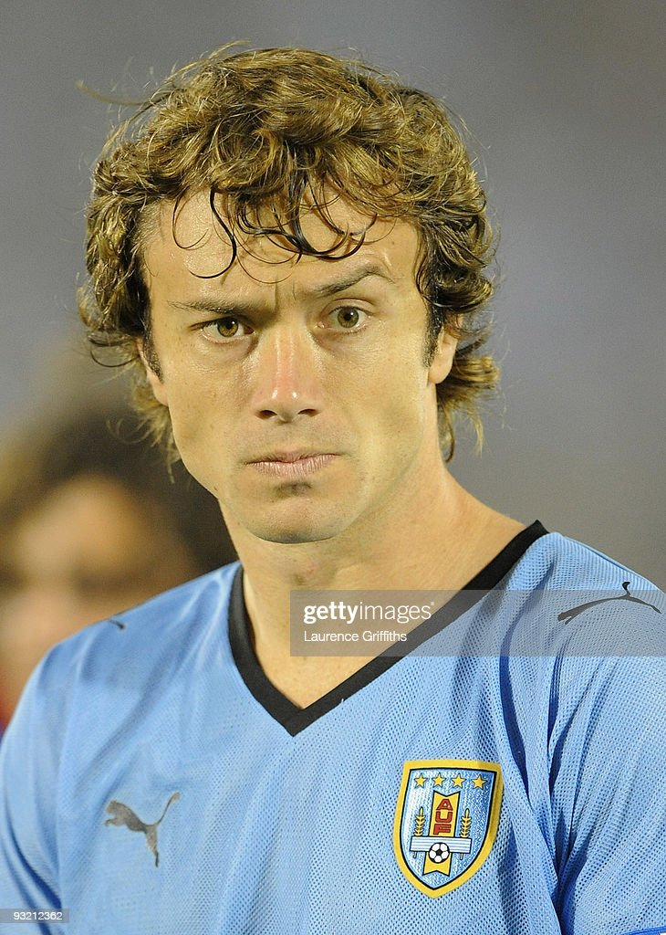 <a gi-track='captionPersonalityLinkClicked' href=/galleries/search?phrase=Diego+Lugano&family=editorial&specificpeople=274735 ng-click='$event.stopPropagation()'>Diego Lugano</a> of Uruguay lines up for the National Anthem duing the 2010 FIFA World Cup Play Off Second Leg Match between Uruguay and Costa Rica at The Estadio Centenario on November 18, 2009 in Montevideo, Uruguay.