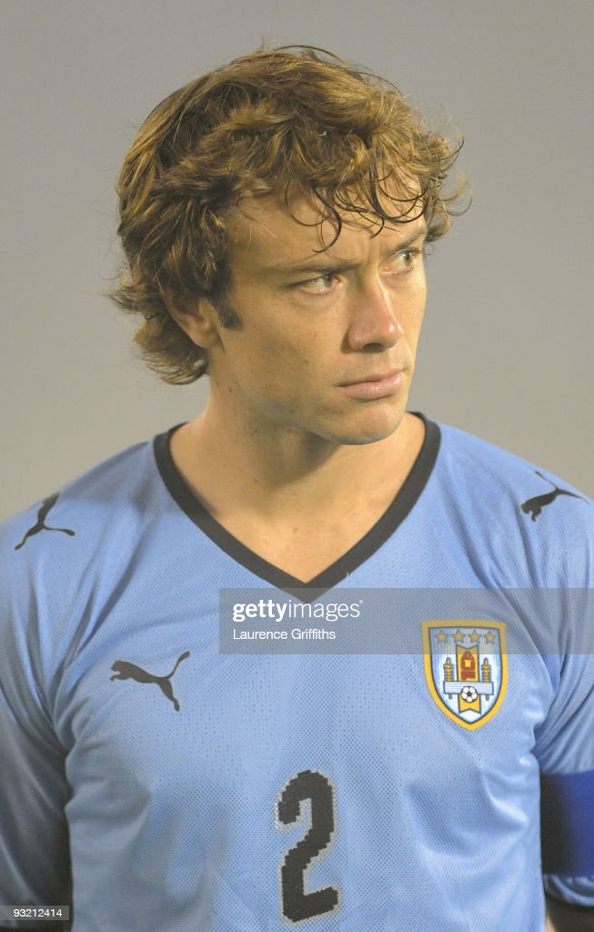 Diego Lugano of Uruguay lines up for the National Anthem duing the 2010 FIFA World Cup Play Off Second Leg Match between Uruguay and Costa Rica at...
