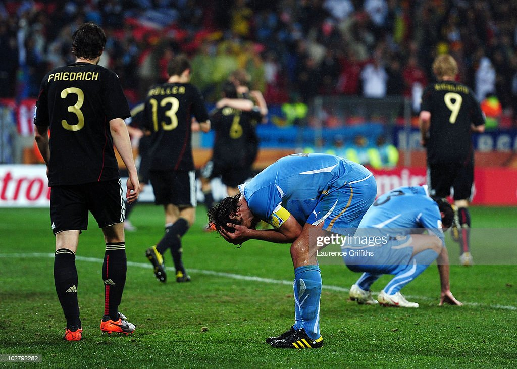 <a gi-track='captionPersonalityLinkClicked' href=/galleries/search?phrase=Diego+Lugano&family=editorial&specificpeople=274735 ng-click='$event.stopPropagation()'>Diego Lugano</a> of Uruguay reacts as Sami Khedira of Germany scores his team's third goal during the 2010 FIFA World Cup South Africa Third Place Play-off match between Uruguay and Germany at The Nelson Mandela Bay Stadium on July 10, 2010 in Port Elizabeth, South Africa.