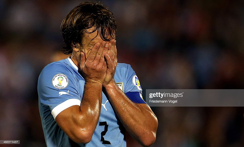 Diego Lugano of Uruguay runs with the ball during leg 2 of the FIFA World Cup Qualifier match between Uruguay and Jordan at Centenario Stadium...