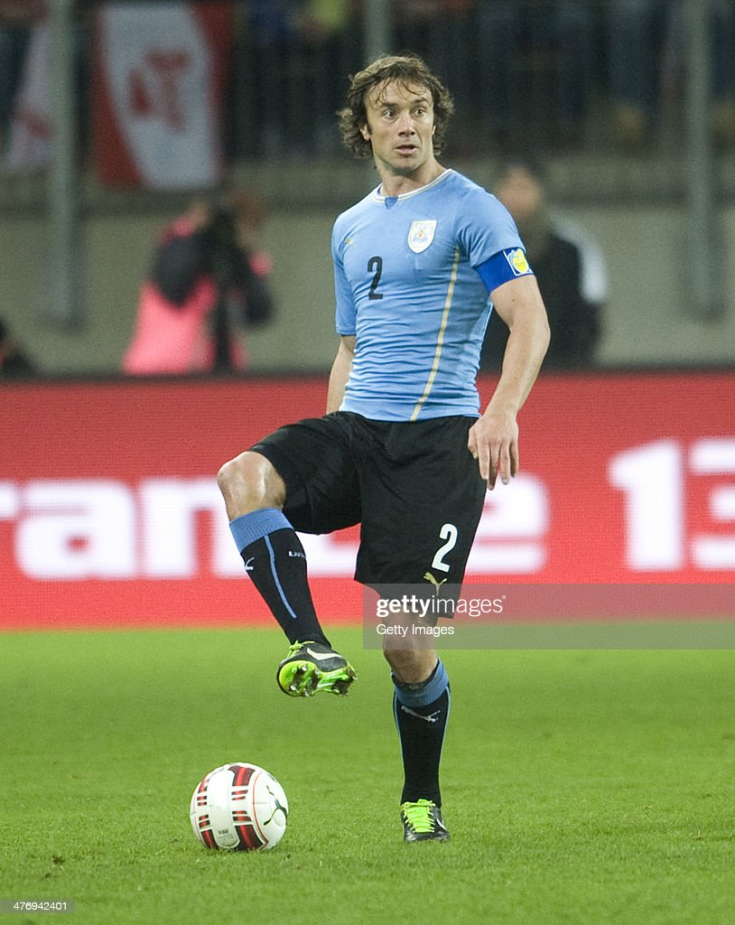 Diego Lugano of Uruguay runs with the ball during the international friendly match between Austria and Uruguay at Woerthersee stadium on March 5 2014...