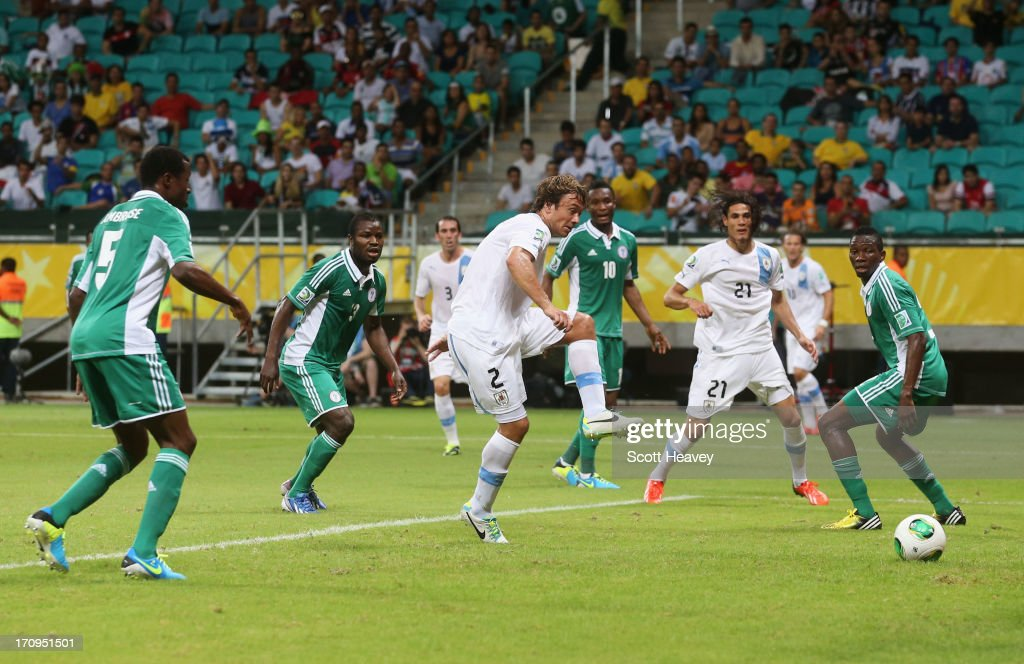 Diego Lugano of Uruguay scores their first goal during the FIFA Confederations Cup Brazil 2013 Group B match between Nigeria and Uruguay at Estadio...