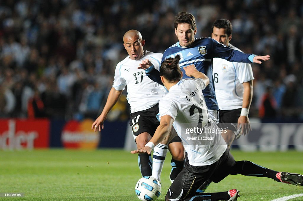 <a gi-track='captionPersonalityLinkClicked' href=/galleries/search?phrase=Diego+Lugano&family=editorial&specificpeople=274735 ng-click='$event.stopPropagation()'>Diego Lugano</a> of Uruguay struggle for the ball with <a gi-track='captionPersonalityLinkClicked' href=/galleries/search?phrase=Lionel+Messi&family=editorial&specificpeople=453305 ng-click='$event.stopPropagation()'>Lionel Messi</a> of Argentina during the game between Argentina and Uruguay as part of the Cuarter Final, of Copa America 2011 at Brigadier Lopez Stadium on july 16, 2011 in Santa Fe, Argentina.